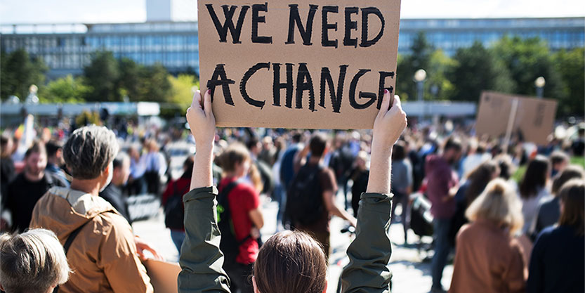 Group of people carrying sign boards